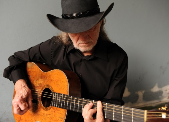 Willie Nelson with guitar, country legend